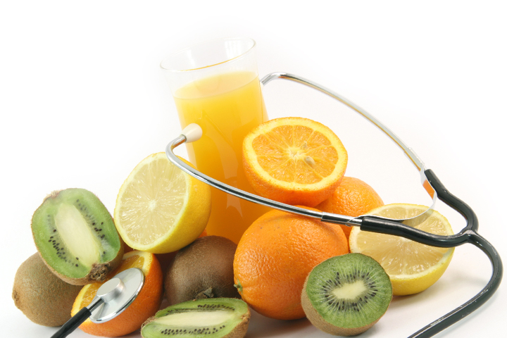 phonedoscope on glass of juice with fruits oranges lemons and kiwi isolated on white background agriculture and healthy eating