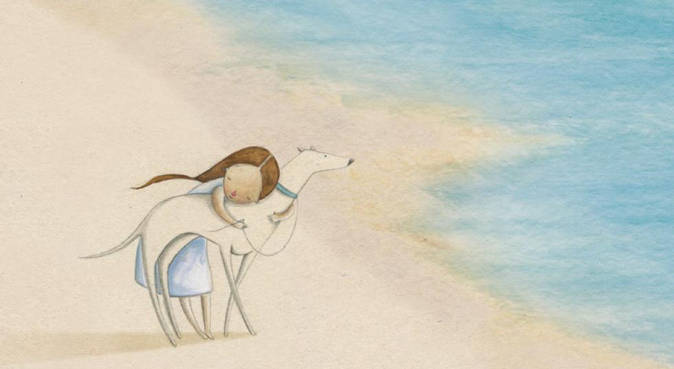 Areia na praia – A amizade entre uma criança e seu animal de estimação