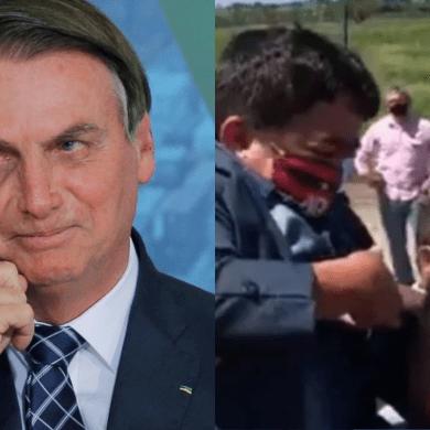 Bolsonaro carrega anão no colo