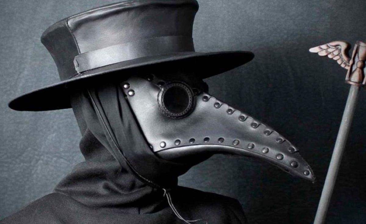 Qual a relação entre a peste negra e a caça às bruxas?